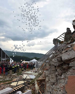 White balloons are released during funeral service for victims of the earthquake in Amatrice.