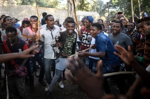 Young men sing and dance