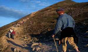 Pilgrims climb up Croagh Patrick near Westport.
