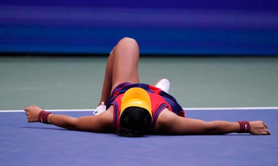 Emma Raducanu drops to the floor after winning the US Open.