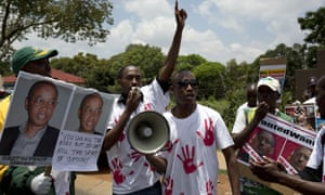 Supporters of the Rwanda National Congress party, founded by Patrick Karegeya, demonstrate in South Africa after his killing in 2014