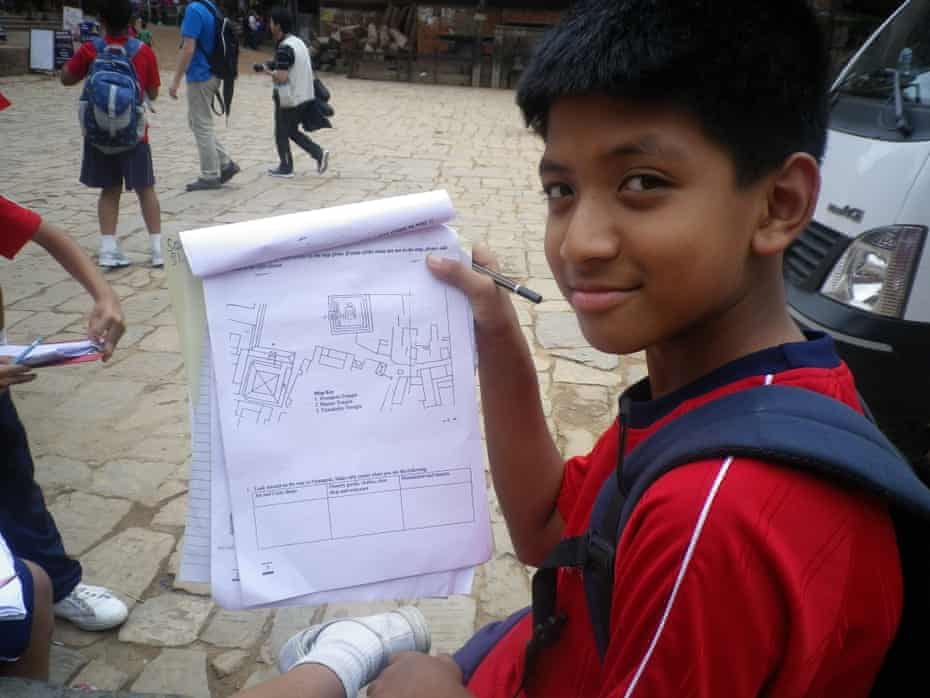 A student from Rato Bangala school in Nepal uses field papers to navigate for the first time. The participants in the exercise were mapping temples around Bhaktapur Durbar Square.