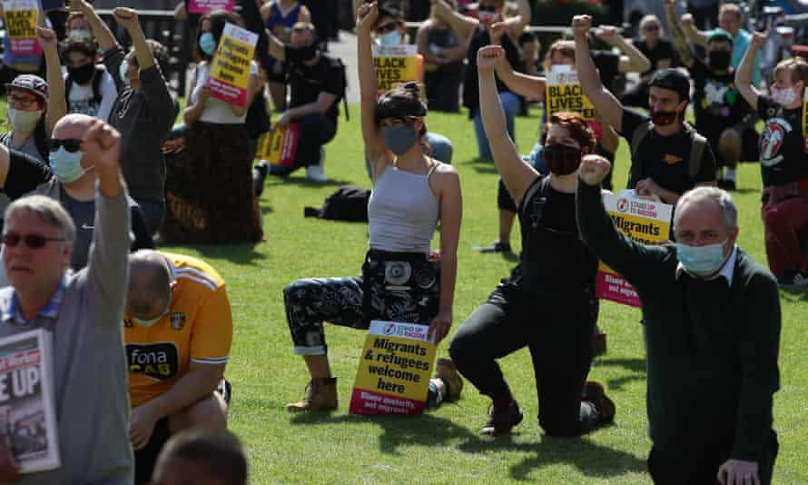 Protesters in George Square, Glasgow, kneel in support of the Black Lives Matter movement.
