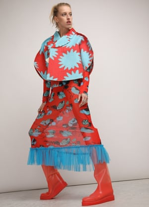 A model wearing a bright blue and red patterned Molly Goddard dress and Comme des Garçons jacket from rental company Higher Studio