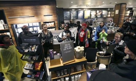 Protesters inside the Starbucks in Philadelphia on Monday where two black men were arrested while they were waiting for a friend in the store.