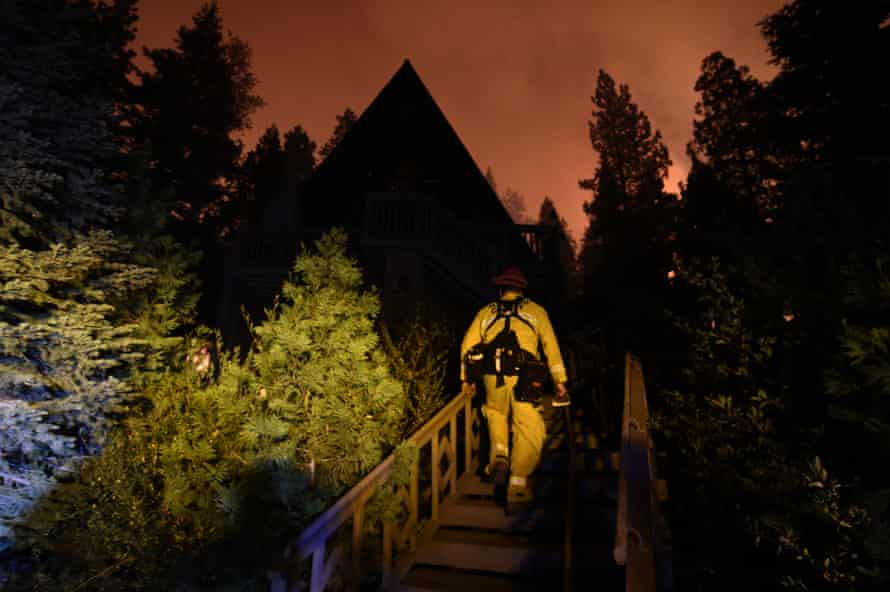 Fire crews battle the Caldor fire on Monday in California.