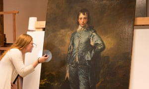 Christina O'Connell, the Huntington's senior paintings conservator, examines the surface of The Blue Boy.