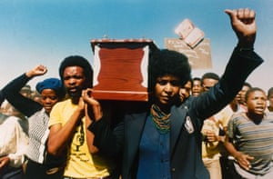 Winnie carries the coffin of William Kotoyi at his funeral in Brandfort