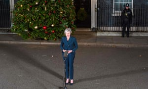 Theresa May makes a statement outside 10 Downing Street, after winning a no-confidence vote.