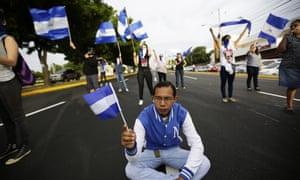 Protesters block a road in Managua, Nicaragua