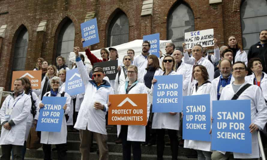 Scientists hold signs during a rally in conjunction with the American Geophysical Union's fall meeting Tuesday, Dec. 13, 2016, in San Francisco. The rally was to call attention to what scientist believe is unwarranted attacks by the incoming Trump administration against scientists advocating for the issue of climate change and its impacts.
