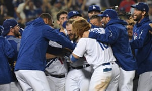 Max Muncy celebrates with teammates after hitting a walk off solo home run