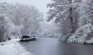 Canal boat moored on the Macclesfield Canal in the snow