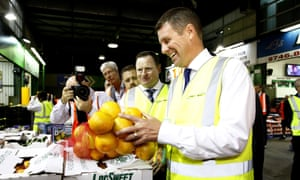 Mike Baird makes an early-morning visit to Flemington markets in Sydney on Thursday.