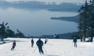 Skiers and snowboarders enjoy spectacular views of Lake Tahoe.