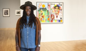 Artist Nina Chanel Abney poses with her work First and Last