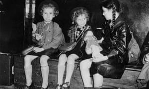 Three Jewish refugee children from Germany and Austria waiting to be collected in London after their evacuation on the Kindertransport.