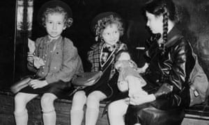 Three Jewish refugee children from Germany and Austria wait at Liverpool Street station in 1939.