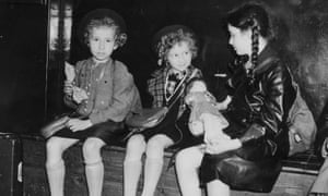 Three Jewish refugee children from Germany and Austria, the 'Kindertransport', waiting to be collected by their relatives or sponsors at Liverpool Street Station, London, after arriving by special train in July 1939