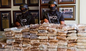 Dominican drug squad officers guard hundreds of kilos of cocaine seized in March 2013