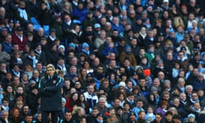 Manchester City's Manuel Pellegrini and fans