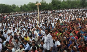 Indian farmers protest during a rally in Gandhinagar, capital of India's Gujarat state, some 30 kms. from Ahmedabad, on June 18, 2013. Nearly 5,000 farmers took out a tractor rally today from Vitthlapur crossroads near Viramgam to Gandhinagar protesting against the Gujarat government's decision to develop Mandal-Becharaji as Special Investment Region (SIR), which also houses Maruti Suzuki India's (MSI) proposed plant. AFP PHOTO / Sam PANTHAKY (Photo credit should read SAM PANTHAKY/AFP/Getty Images)