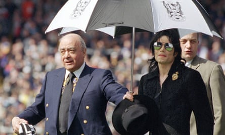 Michael Jackson on the Craven Cottage pitch with Fulham's owner, Mohamed Al Fayed.