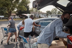 Volunteers distribute food at Faith Restorations in Monaca, PA on Tuesday, August 18, 2020.