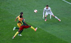 Andre-Frank Zambo Anguissa dinks the ball over Ryan to score his first goal for Cameroon.