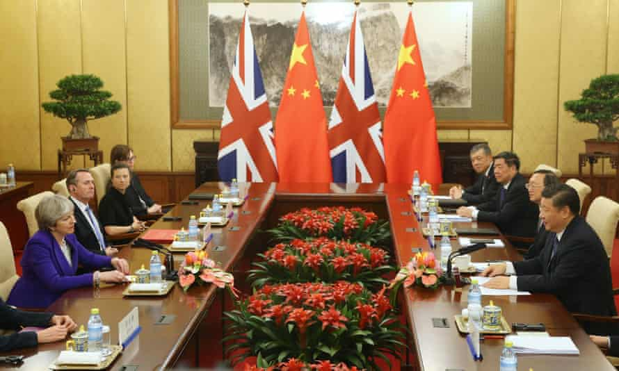 Theresa May and the British delegation meet with Xi Jinping at the Diaoyutai state guesthouse in Beijing .