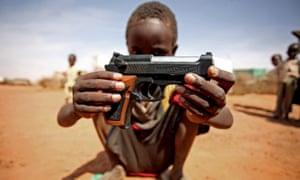 A boy with a gun in Darfur