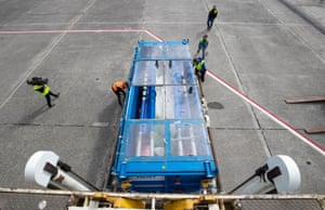 Tanks carrying the whales are inspected as they are unloaded at Keflavík airport.