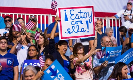 Latino supporters of Hillary Clinton hold a sign saying 'I'm with her' written in Spanish at a campaign rally in Miami, Florida, in July.