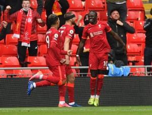 Sadio Mane celebrates scoring the opening goal at Anfield.