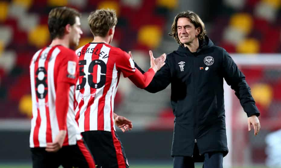 Brentford's manager, Thomas Frank, celebrates with Mads Roerslev after the win at home against Sheffield Wednesday in February.