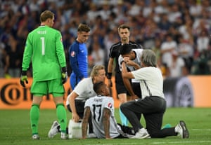 Jerome Boateng lies down after injuring his hamstring.