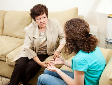 Caring  therapist counseling a teen girl