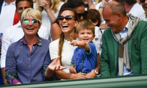 Novak Djokovic's wife and son, Jelena and Stefan, look down upon Centre Court.