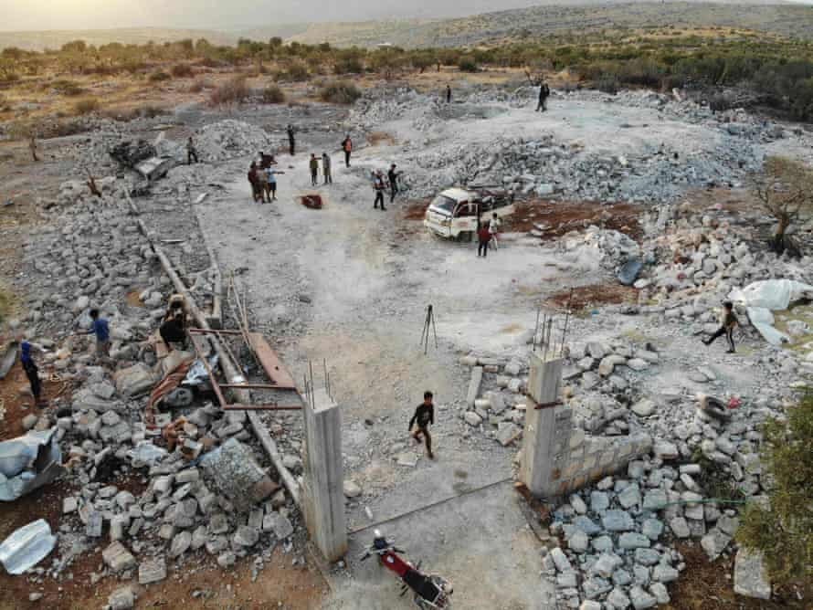 An aerial view of a site hit by helicopter gunfire near the north-western Syrian village of Barisha.