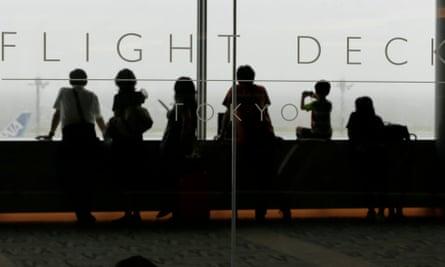 Passengers wait at Haneda airport in Tokyo as typhoon Mindulle hit eastern Japan.