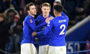 Harvey Barnes takes the acclaim of his teammates after scoring Leicester's second goal against Wigan.