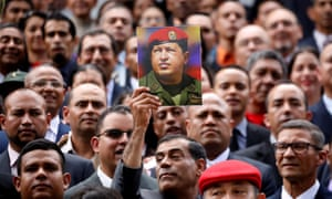 Members of the controversial new constituent assembly, criticized as a power grab, hold a picture of Venezuela's late president Hugo Chávez.