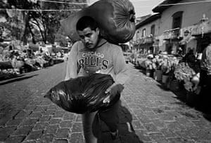 Man With Two Bundles, Wearing Chicago Bulls Sweatshirt, Pátzcuaro, 1999