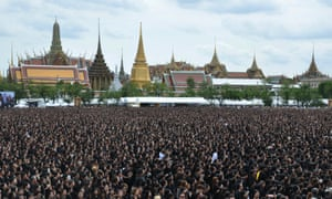 Mourners sing a special version of Thailand's royal anthem in honour of King Bhumibol Adulyadej in Bangkok.