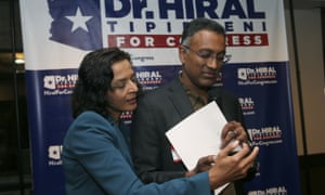 The Democrat Hiral Tipirneni, left, looks over polling results with her husband, Kishore, in February in Glendale, Arizona.