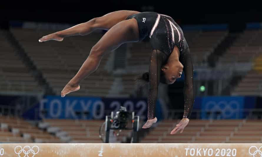 Simone Biles trains on the balance beam at Ariake Gymnastics Centre in Tokyo.