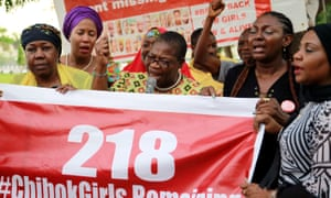 #BringBackOurGirls campaigners with an updated poster after the news that a teenager kidnapped from Chibok more than two years ago has been rescued.