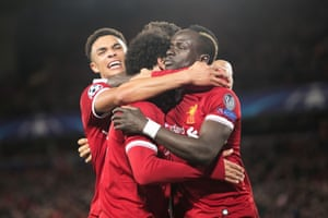 Mane stays stoney faced as he's congratulated by team-mates.
