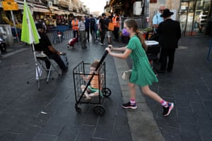Jerusalem, IsraelA girl pushes a trolley with a toddler in it in a main market ahead of Yom Kippur, the Jewish Day of Atonement, as Israel is set to tighten its second nationwide coronavirus lockdown amid a rise in infections