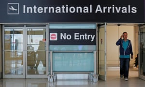 International travelers arrive at Logan Airport on the day that the modified travel ban took effect last month.